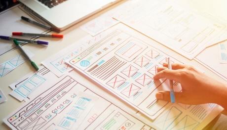 ux ui design diagrams with hands