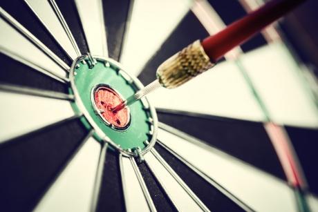 bullseye dart in center of target