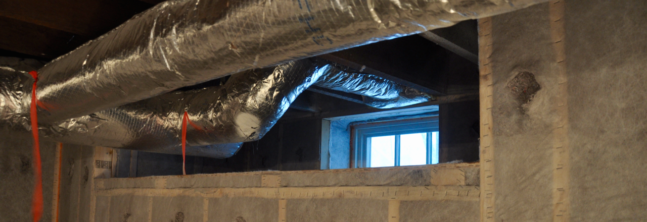 Ducts hanging from the ceiling in a basement