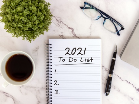 2021 to do list on desk flat lay with glasses coffee and plant