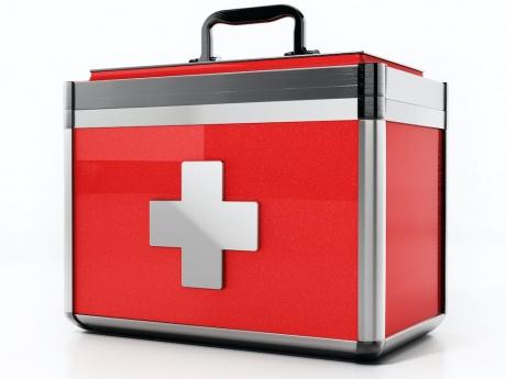 metal doctor's bag with emergency symbol