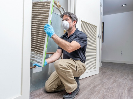 hvac contractor with mask and gloves