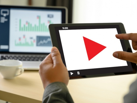 video screen on tablet with computer in the background