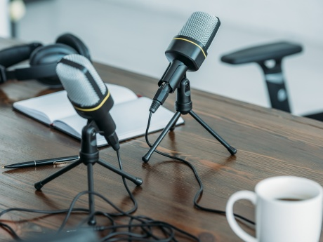 two podcast mics set up on table
