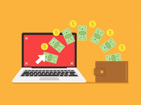 ppc depiction with computer and money flying out of wallet